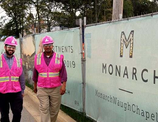 Bozzuto Construction team in pink hard hat and safety vest