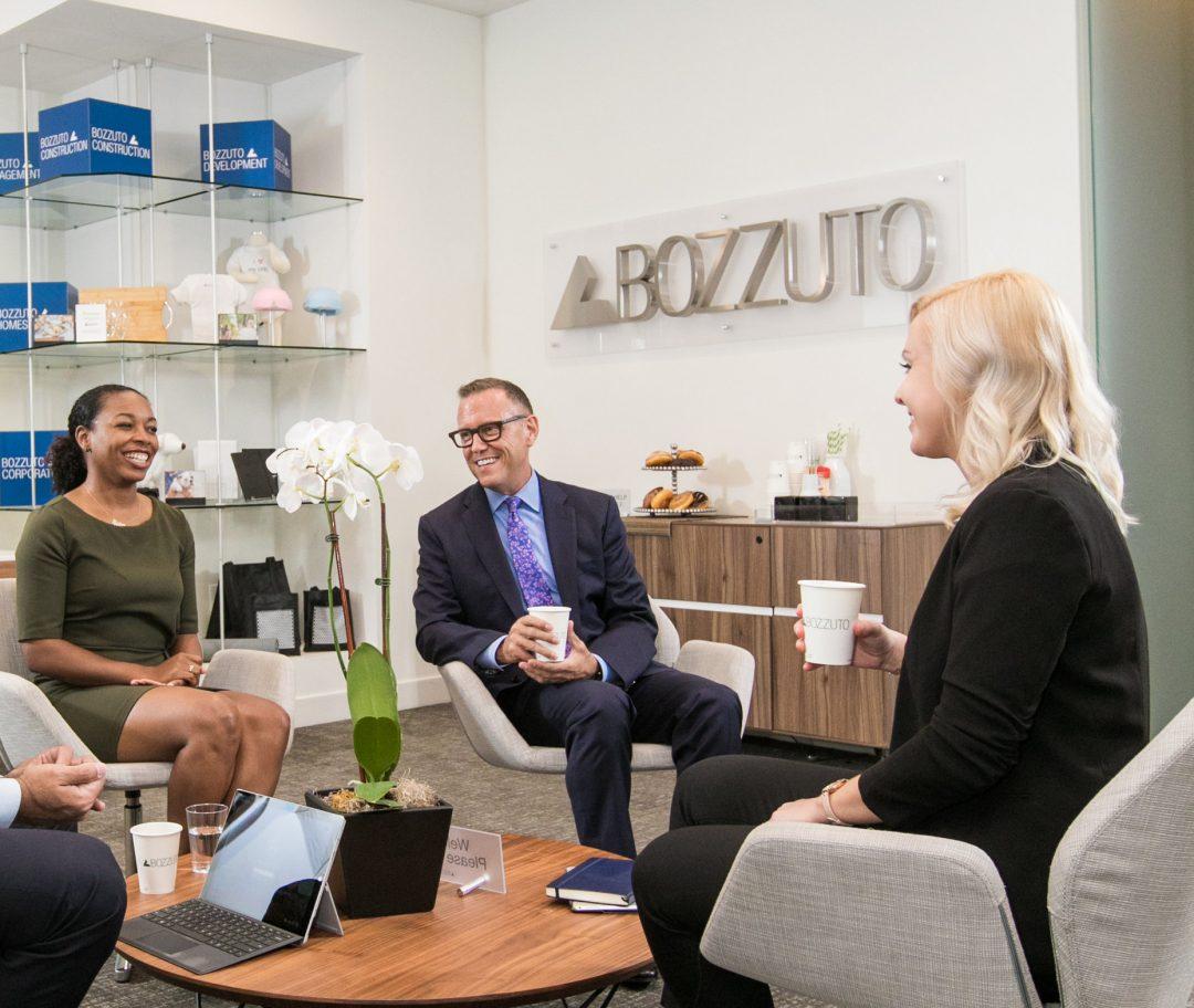 Bozzuto employees sitting down to meet