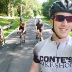 Store manager leads customers on bike ride